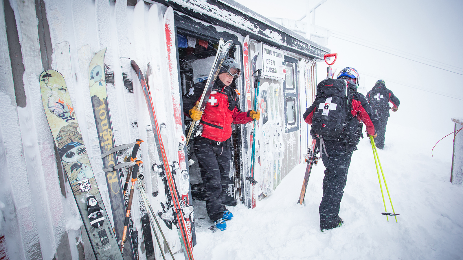 Patrollers walk out of Corbet's Cabin in Jackson Hole. Photo: Amy Jimmerson